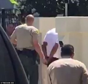 3696E5E100000578-3707832-Cuffed_Dr_Dre_was_patted_down_and_placed_in_handcuffs_after_Sher-a-20_1469492871573-2