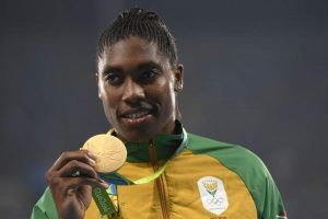 Gold medallist South Africa's Caster Semenya poses on the podium for the Women's 800m Final during the athletics event at the Rio 2016 Olympic Games at the Olympic Stadium in Rio de Janeiro on August 20, 2016. / AFP PHOTO / Eric FEFERBERGERIC FEFERBERG/AFP/Getty Images