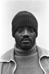darcus howe, black panther, british black panther, black man in hat