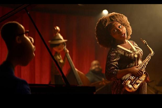 Black man plays piano. Black woman plays saxophone